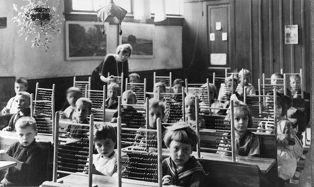 Pupils with counting-frames in classroom, about 1930